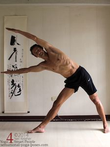 triangle pose with arms lifted and reaching past the head. Neil Keleher. Sensational Yoga Poses.