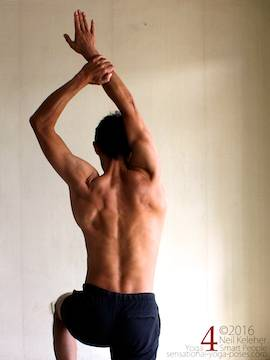 Arm overhead shoulder stretch, pulling one arm to the inside, neil keleher, sensational yoga poses.