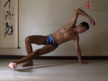learning to balance in side plank, using the top foot to lift the pelvis with the bottom foot also lifted. Neil Keleher. Sensational Yoga Poses.