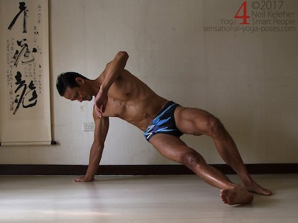 Balancing in side plank, hips lifted, both feet on the  floor. Neil Keleher. Sensational Yoga Poses.