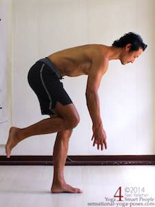 balancing on one leg and slowly bending forwards while keeping the lifted knee pulled forwards. This photo shows the midpoint position with knee lifted and torso almost horizontal. Neil Keleher. Sensational Yoga Poses.