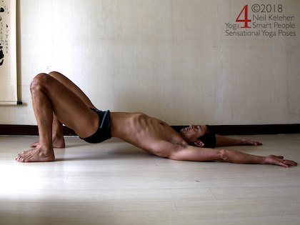 bridge pose with pelvis tilted forwards and hips lifted slightly. Neil Keleher. Sensational Yoga Poses.