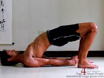 bridge pose with hands clasped Neil Keleher. Sensational Yoga Poses.