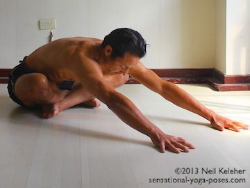Bending forwards with legs crossed, reach ribs away from the pelvis and open the spaces between the ribs. Reach the head away from the ribcage. Reach the shoulders forwards, (towards the ears) and make the arms long. Spread the fingers. Neil Keleher. Sensational Yoga Poses.