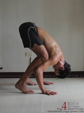 crow pose with head down and looking back. Neil Keleher. Sensational Yoga Poses.