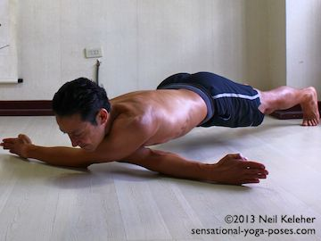 Arm stretches: Dragonfly arm stretch. With body positioned belly down, both arms are positioned across the chest, one in front of the other with elbows straight. The weight of the body is then used to stretch the shoulders of both arms. Neil Keleher. Sensational Yoga Poses.