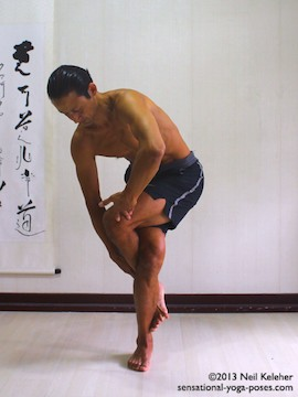 Sensational Yoga Poses, Model Neil Keleher. balancing on one leg while crossing the legs and ankles fully for eagle pose. The foot is hooker around the ankle of my standing leg.