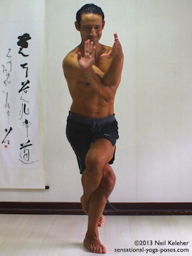 Sensational Yoga Poses, Model Neil Keleher. balancing on one leg with the legs in eagle position as I cross the elbows and get ready to complete eagle position with the arms.