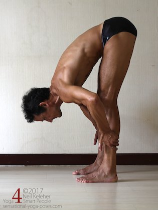Arm strengthening standing forward bend: Grabbing your shins and pulling forwards.  Neil Keleher. Sensational Yoga Poses.