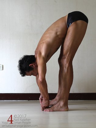 Arm strengthening standing forward bend: Grabbing the big toes and pulling. Neil Keleher. Sensational Yoga Poses.