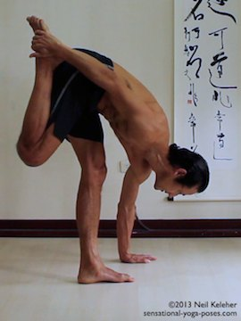 Sensational Yoga Poses, Model Neil Keleher. balancing on one leg while bend forwards with the hand grabbing the lifted ankle in this substitute for lotus pose that is similiar to the quad stretch position