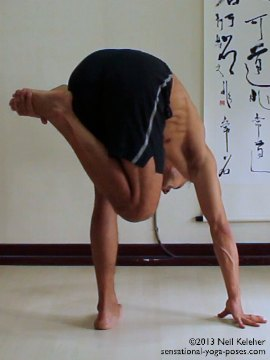 Sensational Yoga Poses, Model Neil Keleher. balancing on one leg with the other knee bent and the hand holding on the foot with the lifted leg externall rotated. I'm grabbing the foot with the opposite hand. One hand is on the floor.