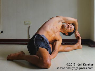 Kneeling Yoga Poses: Half Hero side bend. In this seated semi-kneeling yoga pose, one knee is in hero or kneeling position. The other knee is straight with thighs open 90 degrees. The torso is bent over the straight knee. The bent knee hand is grabbing the straight leg foot. The other hand is resting against the hero leg thigh. Neil Keleher. Sensational Yoga Poses.