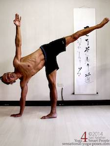 Half moon pose (ardha chandrasana) with weight on one leg, one hand touching the floor. Free leg is straight and lifted in line with torso. Free arm is reaching straight upwards. Gaze is upwards. Neil Keleher. Sensational Yoga Poses.