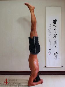bound headstand, yoga pose, to balance in bound headstand, the elbows and crown of the head form a triangle and there is even pressure between elbows and head.