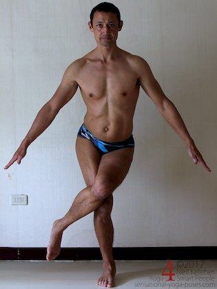 Standing in a variation of eagle pose (ankles not crossed) and controlling pelvic side tilt to strengthen the hips. Neil Keleher. Sensational Yoga Poses.