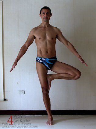 Standing in tree pose and controlling pelvic side tilt to strengthen the hips. Neil Keleher. Sensational Yoga Poses.