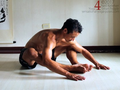 Bound angle forward bend for the hips with feet forwards, away from the pelvis. Neil Keleher. Sensational Yoga Poses.