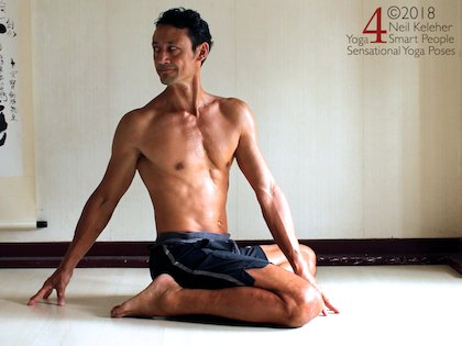 bharadvajasana seated twist variation. basic yoga sequence for flexibility,  combined quad stretch and spinal twist.
