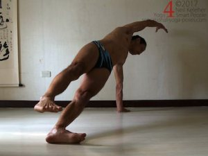 Balancing in Side plank pose with top foot lifted. Neil Keleher. Sensational Yoga Poses.