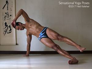 Balancing in side plank with bottom knee and elbow straight and with top leg lifted. Neil Keleher, Sensational Yoga Poses.