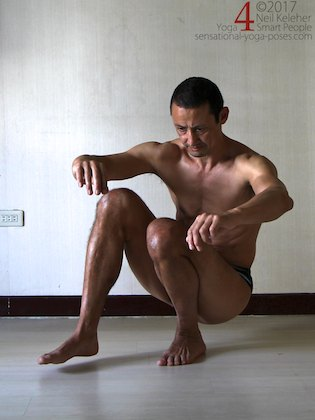 Learning the pistol squat, shifting weight to one leg in a deep  squat. Neil Keleher. Sensational Yoga Poses.