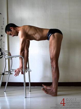 Standing knee exercises: standing forward bend with hands free, the chair is there to rest the hands on should it be needed.