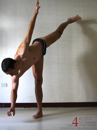 Knee strengthening exericses: half moon pose with knees active and hand lifted.