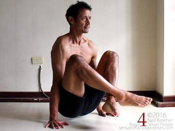 Dangle pose with shoulder blades depressed.  Neil Keleher. Sensational Yoga Poses.
