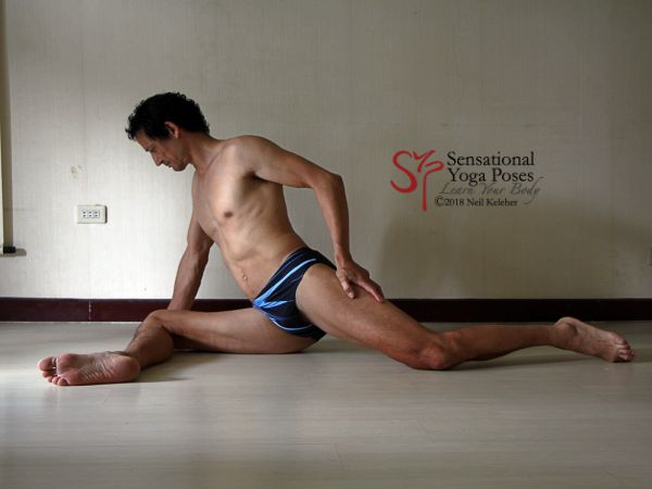 Pigeon pose with front hip on the floor and shin parallel to the front. Neil Keleher. Sensational Yoga Poses.