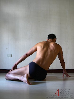 Working towards a lying quadriceps stretch with a modified single leg kneelng position. Neil Keleher. Sensational Yoga Poses.