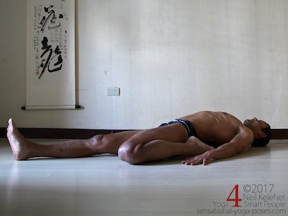 Lying back with one leg kneeling and the other leg straight for a lying quadriceps stretch. Neil Keleher. Sensational Yoga Poses.