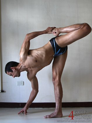 Standing quadriceps and hamstrings stretch, one reason to get more flexible. Neil Keleher. Sensational Yoga Poses.