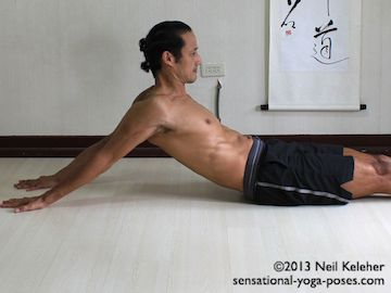 Rack pose shoulder stretch. This is a belly facing up pose with the arms down and back behind the body. Neil Keleher. Sensational Yoga Poses.