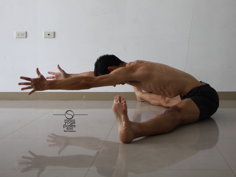 wide leg forward bend, knees straight, reaching forwards with hands off of floor, yoga pose