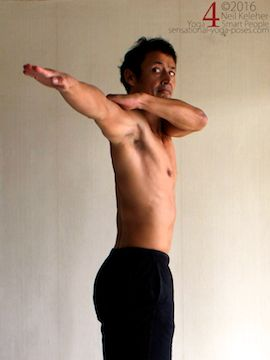 Arm to the side active shoulder stretch, pulling one arm back while holding on to upper arm with other hand, neil keleher, sensational yoga poses.