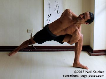 side angle pose (utthitta parsvakonasana) with arms bound behind the back.