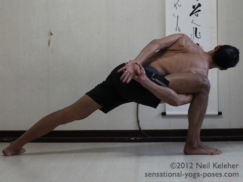 side angle pose, side angle yoga pose with arms bound behind the bck