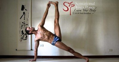 Side plank pose with big toe of top foot grabbed. Neil Keleher, Sensational Yoga Poses.
