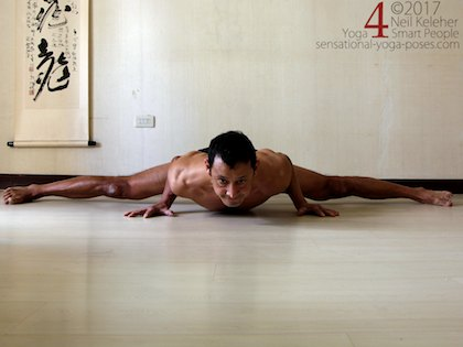 Middle splits. In this version I'm using my arms to help support my body in a push-up like position. Neil Keleher. Sensational Yoga Poses.