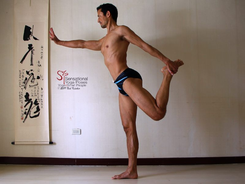 Sensational Yoga Poses, Model Neil Keleher. Balancing on one foot while upright in dance pose or or standing bow with the same side hand grabbing the lifted foot behind the body.