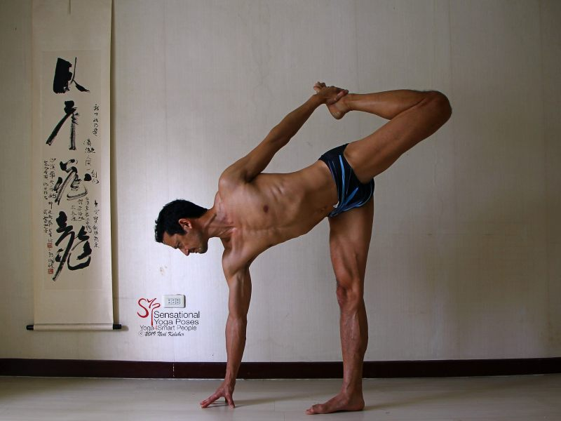Sensational Yoga Poses, Model Neil Keleher. Balancing on one foot in dancer position or standing bow with the non-binding hand touching the floor. I'm holding the inside of the foot with the same side han
