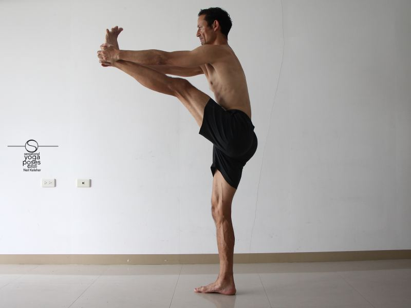 Grabbing a foot while standing to stretch the hamst. Neil Keleher, Sensational Yoga Poses.