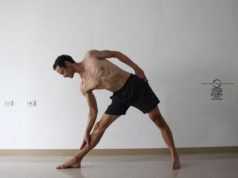 Using triangle yoga pose to stretch the hamstrings Neil Keleher, Sensational Yoga Poses.