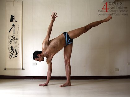 Half moon yoga pose with hand on the floor. Neil Keleher, sensational yoga poses.