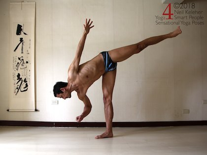 Half moon yoga pose with hand lifted. Neil Keleher, Sensational Yoga Poses