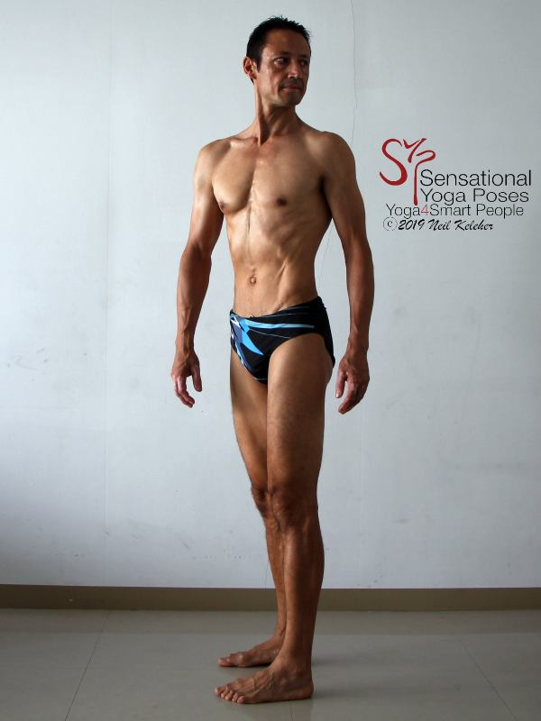 Standing twist with transverse abdominis engaged. Neil Keleher, Sensational Yoga Poses.