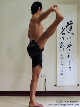 Sensational Yoga Poses, Model Neil Keleher. balancing on one leg in utthitta hasta padangusthasana with leg to the side while holding onto big toe.