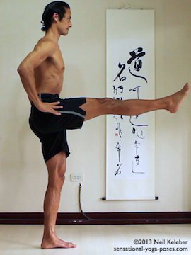 Sensational Yoga Poses, Model Neil Keleher. balancing on one leg in utthitta hasta padangusthasan with leg to the front and both hands on the waist.