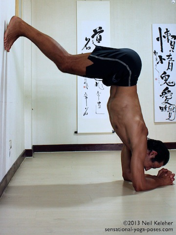 inverted yoga pose, headstand prep using wall, pushing hips away from wall